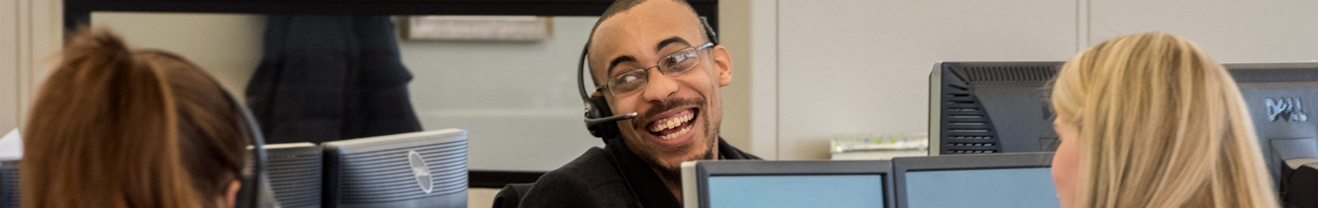 Man smiling at his desk