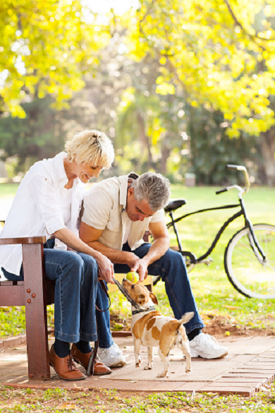 Couple in park with dog