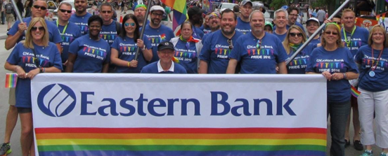 Eastern Bank employees at Boston Pride Parade with banner