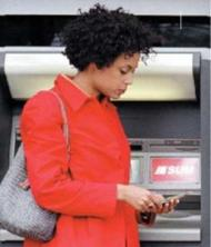 Woman using Eastern bank SUM ATM