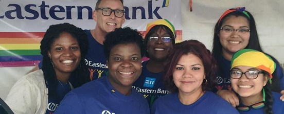 Diverse group of employees at Pride Parade