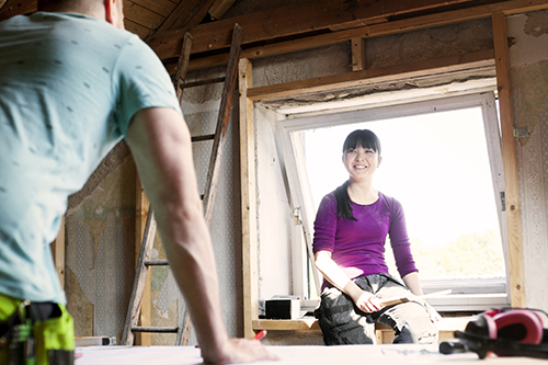 Woman and Man Doing Home Construction