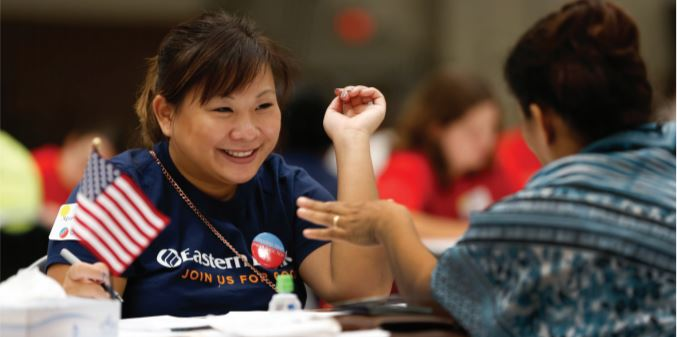 Eastern Bank employee smiling while volunteering at Project Citizenship