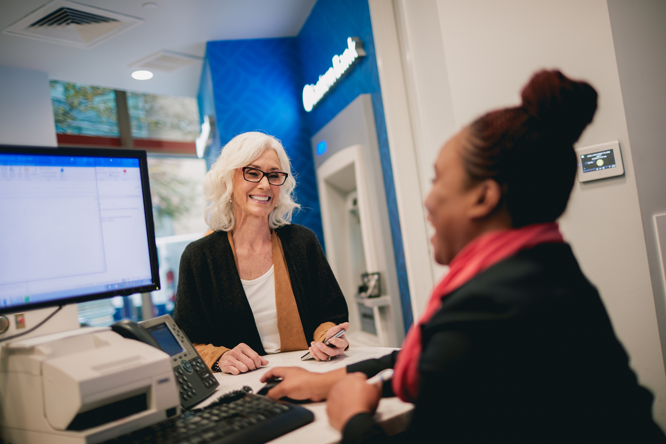 Woman at Teller Line in Branch