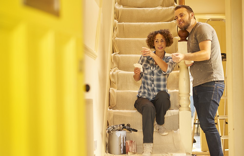 Man and Woman picking out paint color
