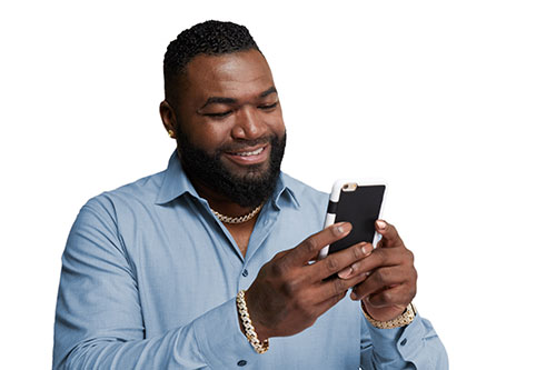 David Ortiz on a mobile phone