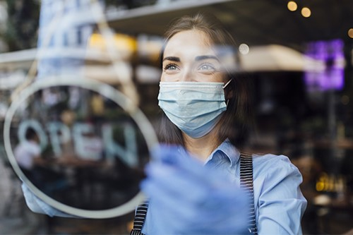 Woman business owner wearing mask