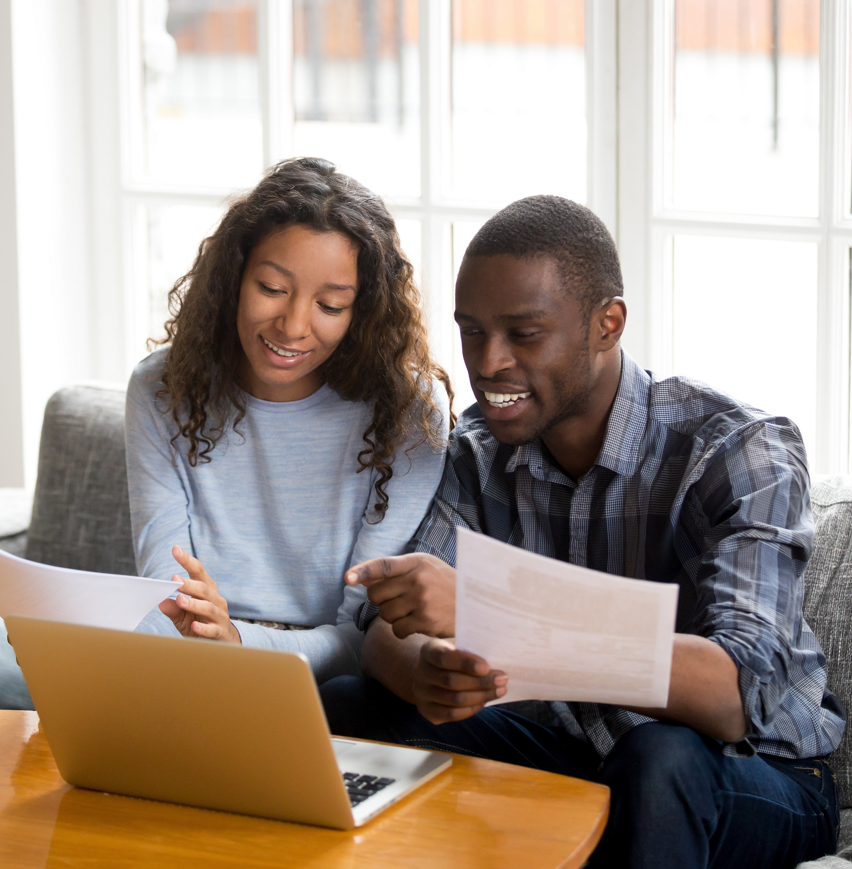 A couple begins the refinance process